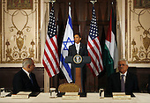New York, NY - September 22, 2009 -- United States President Barack Obama speaks at a trilateral meeting with Israeli Prime Minister Benjamin Netanyahu (L) and Palestinian President Mahmoud Abbas (R) at the Waldorf Astoria Hotel in New York City on September 22, 2009.   .Credit: John Angelillo / Pool via CNP
