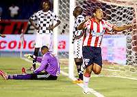 BARRANQUIILLA -COLOMBIA-02-04-2014. Martín Arzuaga (Der) de Atlético Junior celebra un gol anotado a Boyacá Chicó durante partido por la fecha 14 de la Liga Postobón I 2014 jugado en el estadio Metropolitano Roberto Meléndez de la ciudad de Barranquilla./ Atletico Junior  player Martin Arzuaga (R) celebrates a goal scored to Boyaca Chico during match for the 14th date of the Postobon League I 2014 played at Metropolitano Roberto Melendez stadium in Barranquilla city.  Photo: VizzorImage/Alfonso Cervantes/STR