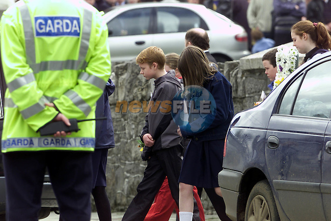 the remains of sisters Ann Marie and Michelle Fitzsomins are taken from the Church in Oldcastle to the grave yard down the road after the funeral mass followed by there brother and sisters..Pic Fran Caffrey Newsfile.©Newsfile Ltd.