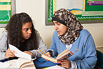 Education High School two female students working together