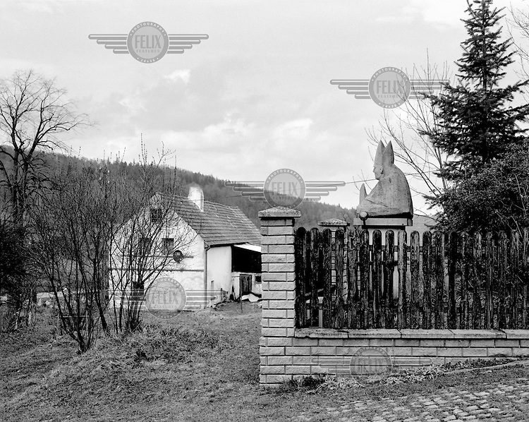 A statue of Pope John Paul II overlooks the village of Zdanow.