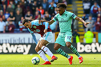 Burnley's Dwight McNeil battles with Arsenal's Alex Iwobi<br /> <br /> Photographer Alex Dodd/CameraSport<br /> <br /> The Premier League - Burnley v Arsenal - Sunday 12th May 2019 - Turf Moor - Burnley<br /> <br /> World Copyright &copy; 2019 CameraSport. All rights reserved. 43 Linden Ave. Countesthorpe. Leicester. England. LE8 5PG - Tel: +44 (0) 116 277 4147 - admin@camerasport.com - www.camerasport.com