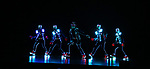 """Cast of Light Balance from Broadway's """"The Illusionists—Magic of the Holidays"""" on stage for a press preview at the Marquis Theatre  on November 27, 2018 in New York City."""