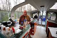 Michael Devitt serves refreshments for first-class passengers on the Alaska Railroad's Goldstar service.