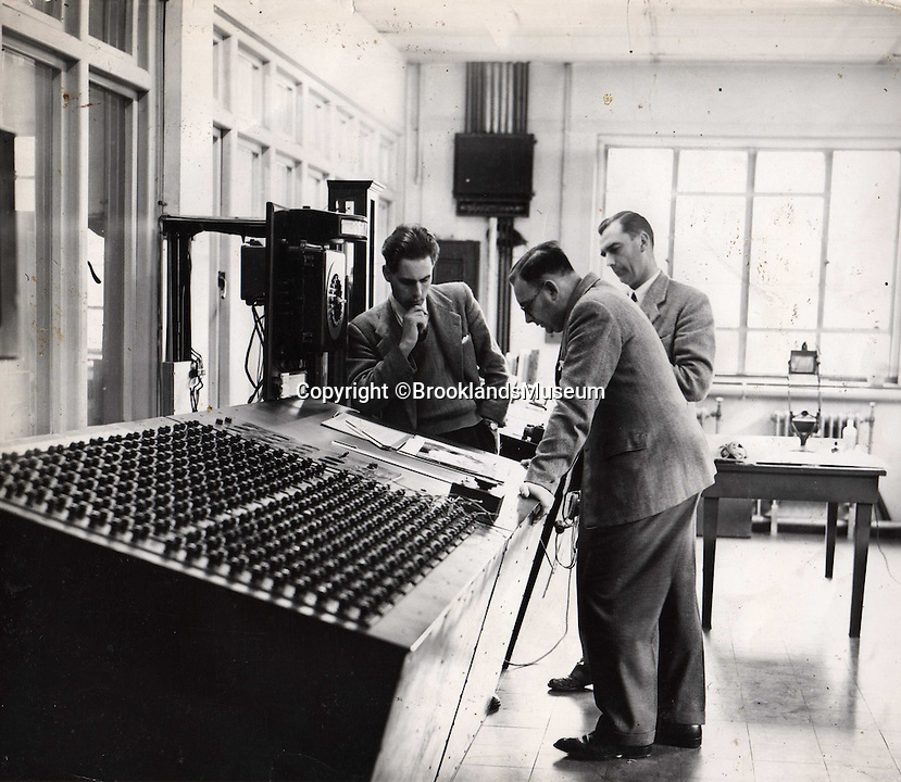 BNPS.co.uk (01202 558833)<br /> Pic: BrooklandsMuseum/BNPS<br /> <br /> Boffins at work in the cotrol room.<br /> <br /> The coldest of Cold War relics has opened to the public after years of secrecy. <br /> <br /> Barnes Wallis's amazing Stratosphere Chamber was built at Brooklands in 1947 to test aircraft in high altitude conditions of flight.<br /> <br /> Constructed from the hull of a nuclear submarine the 340 ton structure could replicate temperatures down to -60 centigrade at 60,000 feet, as well as blasting rain, sleet or snow at 40 kts through the sealed chamber.<br /> <br /> As well as aircraft the facility was also used to test naval equipment in freezing arctic conditions, and even the effects of icing on trawler rigging.<br /> <br /> The gigantic structure, containing the cockpit of a Viscount passenger aircraft, has now been spruced up and is open to the public at the Brooklands Museum in Weybridge.