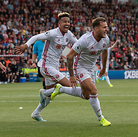 Sheffield United's Billy Sharp (right) celebrates scoring his side's first goal with Sheffield United's Cullum Robinson (left) <br /> <br /> Photographer David Horton/CameraSport<br /> <br /> The Premier League - Bournemouth v Sheffield United - Saturday 10th August 2019 - Vitality Stadium - Bournemouth<br /> <br /> World Copyright © 2019 CameraSport. All rights reserved. 43 Linden Ave. Countesthorpe. Leicester. England. LE8 5PG - Tel: +44 (0) 116 277 4147 - admin@camerasport.com - www.camerasport.com