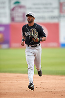 Lansing Lugnuts center fielder Joshua Palacios (2) jogs to the dugout during a game against the Clinton LumberKings on May 9, 2017 at Ashford University Field in Clinton, Iowa.  Lansing defeated Clinton 11-6.  (Mike Janes/Four Seam Images)