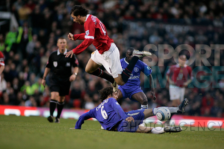 Manchester United's Ruud Van Nistelrooy tackled by Ricardo Carvalho in the Premiership match at Old Trafford, Manchester, 10 May, 2005..Pic © Simon Bellis, 33 Parkway New Mills, High Peak, SK22 4DU..Any problems call 07980659747 or 01663 746519. .email: simon@simonbellis.com