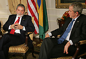 Brazil's president Luiz Lulu da Silva, left, talks to the media as United States President George W. Bush listnes during their meeting at the Waldorf hotel on September 24, 2007in New York City. Bush will be meeting with several heads of state who are in the city for the United Nation's General Assembly meeting.  <br /> Credit: Monika Graff / Pool via CNP