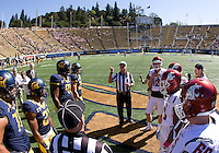 California and Washington captains watch referee Jack Wood tosses the coin during coin toss ceremony before the game at Memorial Stadium in Berkeley, California on October 5th, 2013.  Washington State defeated California, 44-22.