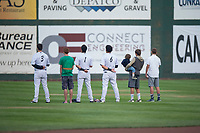Idaho Falls Chukars outfielders Hunter Strong (3), Andres Martin (1), and Jose Caraballo (6) stand alongside some young fans during the National Anthem before a Pioneer League game against the Billings Mustangs at Melaleuca Field on August 22, 2018 in Idaho Falls, Idaho. The Idaho Falls Chukars defeated the Billings Mustangs by a score of 5-3. (Zachary Lucy/Four Seam Images)