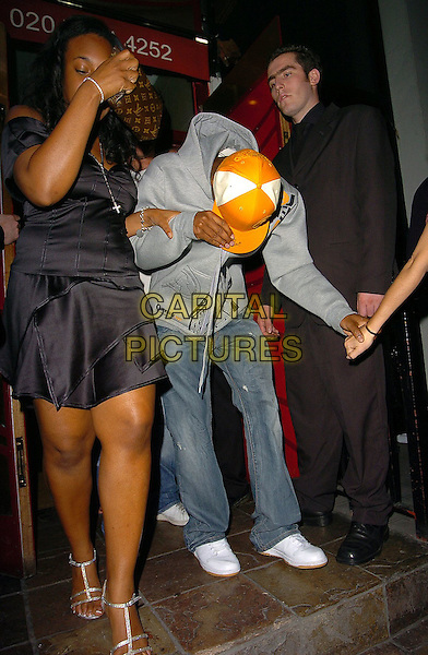 SIMON WEBBE & GIRLS.At Blue's End Of Tour Party, .Eve Club, London,.July 9th 2005..full length yellow hat cap grey top holding hands guests hiding bending down funny.Ref: CAN.www.capitalpictures.com.sales@capitalpictures.com.©Can Nguyen/Capital Pictures