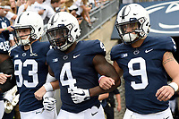STATE COLLEGE, PA - SEPTEMBER 1: Penn State captains: P Blake Gillikin (93), S Nick Scott (4), and QB Trace McSorley (9) walk arm in arm out the tunnel for the coin toss. The Penn State Nittany Lions defeated the Appalachian State Mountaineers 45-38 in overtime on September 1, 2018 at Beaver Stadium in State College, PA. (Photo by Randy Litzinger/Icon Sportswire)
