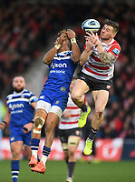 4th January 2020; Kingsholm Stadium, Gloucester, Gloucestershire, England; English Premiership Rugby, Gloucester versus Bath; Anthony Watson of Bath and Jason Woodward of Gloucester compete in the air - Editorial Use