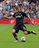 Tom Carroll of Swansea City crosses the ball during the Premier League match between West Ham United v Swansea City at the London Stadium, London, England, UK. Saturday 30 September 2017