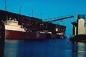 M/V J Burton Ayers awaits a load of iron ore pellets at the LS&I ore dock in Marquette Michigan's upper harbor on Lake Superior. Circa 1970's