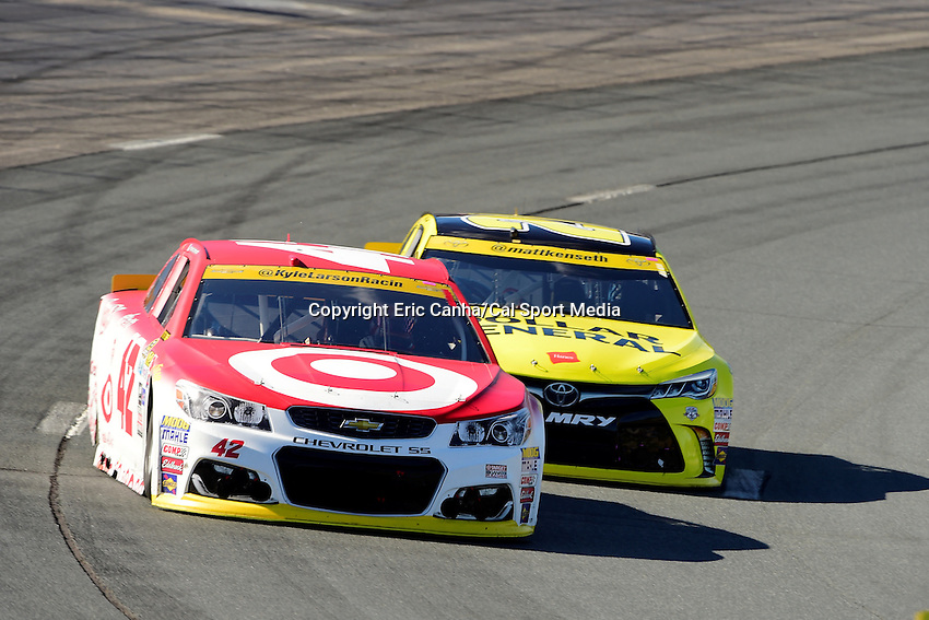 Sunday, September 25, 2016: Sprint Cup Series driver Kyle Larson (42) leads Sprint Cup Series driver Matt Kenseth (20) into a turn at the NASCAR Sprint Cup Series Bad Boy Off Road 300 race held at the New Hampshire Motor Speedway in Loudon, New Hampshire. Sprint Cup Series driver Kevin Harvick (4) won the race. Eric Canha/CSM