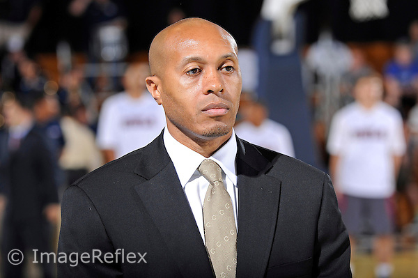 25 January 2014:  FIU Men's Basketball Head Coach Anthony Evans watches players warm up prior to the game as the FIU Golden Panthers defeated the Florida Atlantic University Owls, 66-57, at the U.S. Century Bank Arena in Miami, Florida.