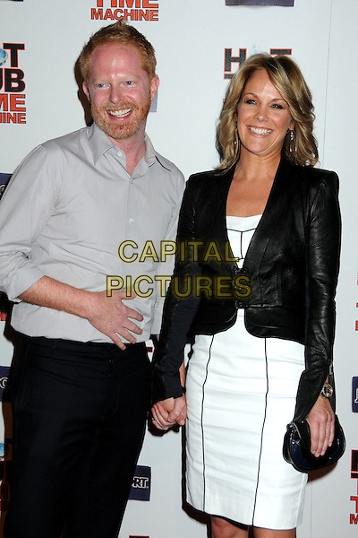 "JESSE TYLER FERGUSON & GUEST.""Hot Time Time Machine"" World Premiere Party held at the Cabana Club, Hollywood, California, USA..March 17th, 2010.half length beard facial hair grey gray white shirt black blazer white dress holding hands clutch bag .CAP/ADM/BP.©Byron Purvis/AdMedia/Capital Pictures."