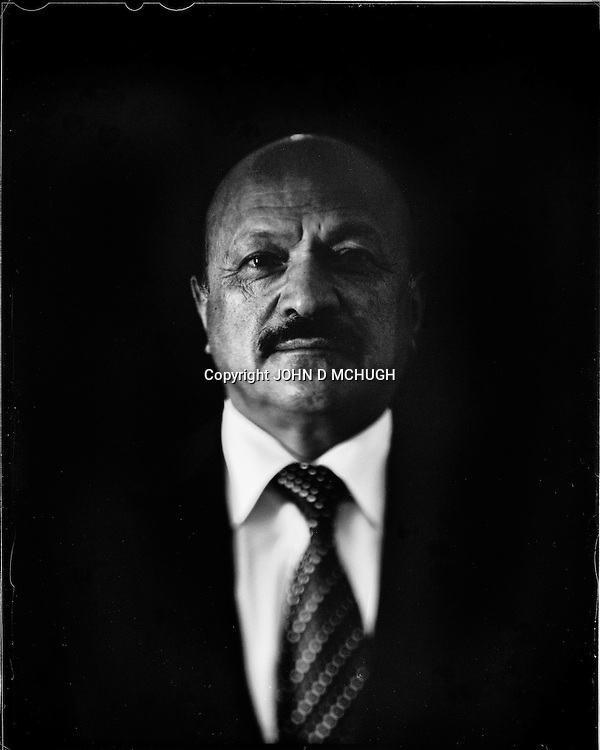 "Muhammad Yunus Nawandish, the Mayor of Kabul, is seen in his office, 25 August 2012. This portrait was shot on a 5x4 Linhof Technika IV, circa 1959, and a Schneider Kreuznach 270mm lens, circa 1952, with front tilt, and is part of a series entitled ""Putting an Afghan face on the war."" (John D McHugh)"