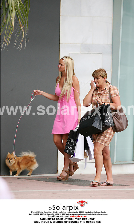 ALL ROUND EXCLUSIVE PICTURES FROM SOLARPIX.COM - 30.04.06.Jennifer Ellison had a spot of shoe trouble this weekend while on a shopping spree with two friends and a small dog to trendy Puerto Banus on the Costa Del Sol. She arrived for the excursion wearing a pair of brown high heel sandals, which were obviously giving her some jip, so she popped into a shop and came out with a pair of white sandals which broke after five minutes. She was then spotted inside a shop in bare feet and emerged wearing a pair of bright green sandals..Aaahh...comfort at last!!.The three ladies then strolled around the shops for another hour and any bags that  Jennifer could not manage, were dumped on her older friend who acted as the sherpa..When they finally ground to a halt, the girls stopped at an Italian restaurant where Jennifer showed her friends a Christian Dior baby bottle she had just bought....Was it a gift? Or are things between her and fianc? Tony Richardson really hotting up?.REF: 2293 AB1