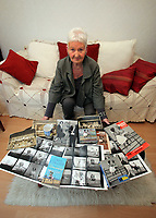 Pictured: Pat Stewart at her home in Llantwit Major with a selection of items bearing the iconic image taken by Bert Hardy and other mementos from the same era. <br />