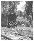 RGS caboose #0403 at Muldoon (MP 85) with B-end stove in by run-away flat car from Rico.<br /> RGS  Muldoon, CO  7/26/1948
