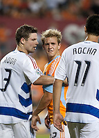 Houston Dynamo midfielder Stuart Holden (22), FC Dallas defender Drew Moor (3), and FC Dallas midfielder Andre Rocha (11) exchange words.  Houston Dynamo defeated FC Dallas 1-0 at Robertson Stadium in Houston, TX on May 9, 2009
