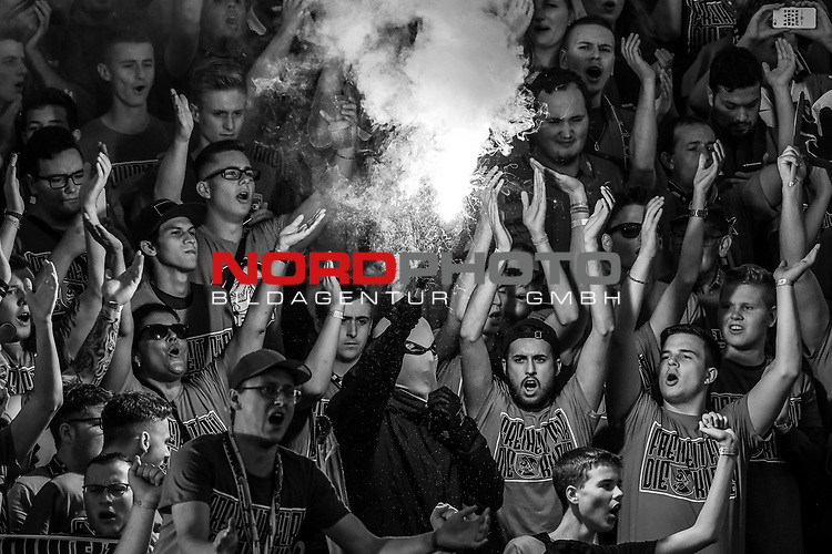 10.08.2019, Donaustadion, Ulm, GER, DFB Pokal, SSV Ulm 1846 Fussball vs 1. FC Heidenheim, <br /> DFL REGULATIONS PROHIBIT ANY USE OF PHOTOGRAPHS AS IMAGE SEQUENCES AND/OR QUASI-VIDEO, <br /> im Bild Bengalos, Pyrotechnik im Heidenheimer Fanblock, vermummter Heidenheimer Ultra, schwarz/weiss<br /> <br /> Foto © nordphoto / Hafner