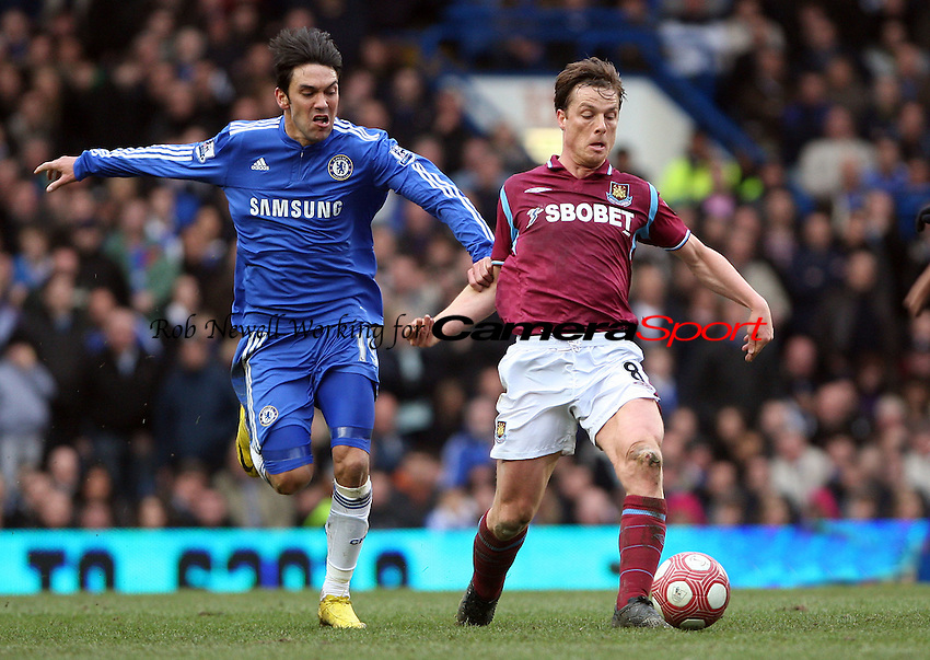 Scott Parker of West Ham and Paulo Ferreira of Chelsea - Chelsea vs West Ham United, Barclays Premier League at Stamford Bridge, Chelsea - 13/03/10 - MANDATORY CREDIT: Rob Newell/TGSPHOTO - Self billing applies where appropriate - 0845 094 6026 - contact@tgsphoto.co.uk - NO UNPAID USE.