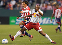 Red Bulls Def. Marvell Wynne reaches for a loose ball against CD Chivas USA Mid. Francisco Mendoza during a 0-0 tie between Chivas USA vs NY Red Bulls in a MLS game at The Home Depot Center in Carson, California Saturday, April, 29, 2006.