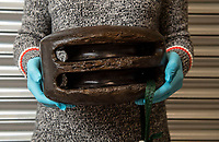 BNPS.co.uk (01202 558833)<br /> Pic: PhilYeomans/BNPS<br /> <br /> Incredibly well preserved wooden blocks have also been found.<br /> <br /> Fascinating artefacts salvaged from a historic gun ship which sunk off the British coast 261 years ago have gone on display for the first time.<br /> <br /> The French built ship is credited with transforming the Georgian Royal Navy after its capture in 1747 when trials revealed it was sleeker and better armed than British warships of the day.<br /> <br /> Unfortunately HMS Invincible  became wrecked on a shallow sand bank in the Solent in 1758 when en route to fhelp fight the French in Canada.<br /> <br /> The wreck, which is three nautical miles from Portsmouth, Hants, was first discovered by a fisherman in shallow 25ft waters 40 years ago. However, changing sea bed levels in the past few years have left it more exposed to the elements, leading to fears the relics could deteriorate.<br /> <br /> This prompted archaeologists to carry out a full scale excavation, with 1,458 dives taking place between 2017 and 2019 - during which nearly 2,000 artefacts were recovered.<br /> <br /> The array of new finds, including the ship's enormous cutwater - the forward curve of the ship's stem - have now been unveiled at the MAST Archaeological Centre in Poole, Dorset. They will eventually go on display at the National Museum of the Royal Navy in Portsmouth.<br /> <br /> Mr Pascoe said the HMS Invincible's innovative longer, streamlined design was copied by the British who adopted it on their ships up until the Battle of Trafalgar (1805).