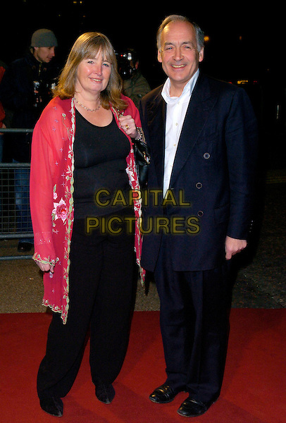 """ALISTAIR STEWART & WIFE.Arrivals - """"An Audience With Lionel Richie"""" TV recording, ITV Television Centre, Aouth Bank, London, England, December 9th 2006..full length married husband wife.CAP/CAN.©Can Nguyen/Capital Pictures"""