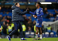 11th January 2020; Stamford Bridge, London, England; English Premier League Football, Chelsea versus Burnley; Chelsea Manager Frank Lampard congratulating Callum Hudson-Odoi of Chelsea after full time - Strictly Editorial Use Only. No use with unauthorized audio, video, data, fixture lists, club/league logos or 'live' services. Online in-match use limited to 120 images, no video emulation. No use in betting, games or single club/league/player publications