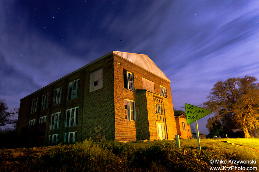 Abandoned school building at night in Kinross, IA
