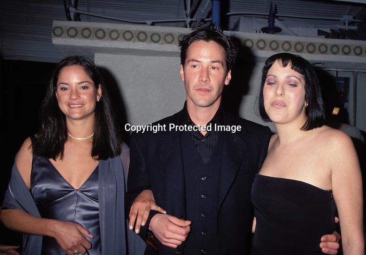 "©1999 KATHY HUTCHINS / HUTCHINS PHOTOS.PREMIERE OF   "" THE MATRIX"".LOS ANGELES, CA   3/24/99..KEANU REEVES AND HIS SISTERS.KORRINE & KIM REEVES"
