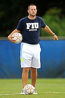 2 October 2011:  FIU Assistant Coach Chris Rich puts players through drills prior to the match.  The FIU Golden Panthers defeated the University of Kentucky Wildcats, 1-0 in overtime, at University Park Stadium in Miami, Florida.