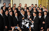 United States President Barack Obama poses with the Stanley Cup champion Los Angeles Kings to the White House to honor their 2012 championship seasons in a ceremony in the East Room of the White House March 26, 2013 in Washington, DC. .Credit: Olivier Douliery / Pool via CNP