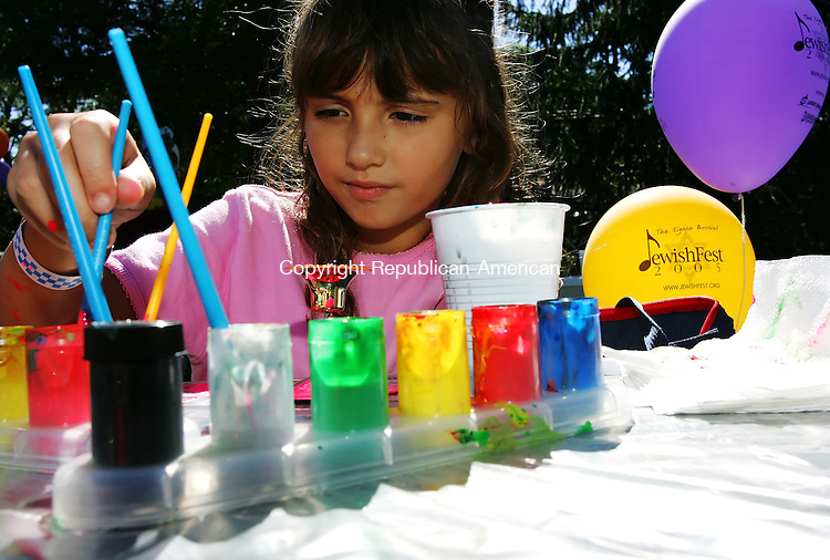 MIDDLEBURY, CT - 09 September 2005 -090905JS05--April Grinsanti, 9, of Norwalk, paints a Shabbat candle holder at the crafts table during the 8th annual JewishFest 2005 at Quassy Amusement Park in Middlebury.  --Jim Shannon / Republican-American  -- April Grinsanti; Quassy Amusement Park; Middlebury are CQ