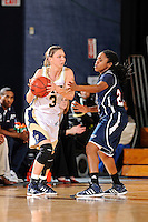21 January 2012:  FIU guard Zsofia Labady (3) handles the ball while being defended by FAU guard Takia Brooks (22) in the first half as the Florida Atlantic University Owls defeated the FIU Golden Panthers, 50-49, at the U.S. Century Bank Arena in Miami, Florida.