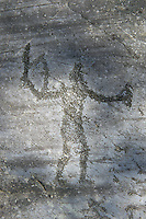 Petroglyph, rock carving, of two feet outlines. Carved by the ancient Camunni people in the iron age between 1000-1600 BC. Rock no 24,  Foppi di Nadro, Riserva Naturale Incisioni Rupestri di Ceto, Cimbergo e Paspardo, Capo di Ponti, Valcamonica (Val Camonica), Lombardy plain, Italy