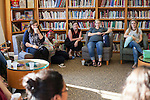 Dr. M. Geneva Murray, center, director of the Women's Center, listens to women answer ice breaker questions at the Women in Graduate School Coffee Hour in the Women's Center in Baker University Center on Tuesday, September 6, 2016.
