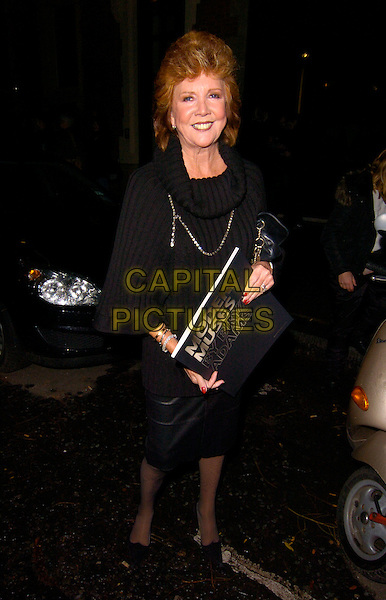 CILLA BLACK.Bryan Adams: Modern Muses - private view, The Hospital, London, England..November 27th, 2007.full length black dress skirt book cowel neck .CAP/CAN.©Can Nguyen/Capital Pictures