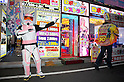 "July 23 2012, Tokyo, Japan - A man wears as a soldier of the Star Wars movie announces the ""Robot Restaurant"" at Kabukicho in Shinjuku. The restaurant advertises that cost 10 billion yen (130 million) opening. Robots run by real women dressed in military, perform cabaret dance for its customers, opened in the Kabukicho area, Shinjuku in Tokyo. (Photo by Rodrigo Reyes Marin/AFLO)"