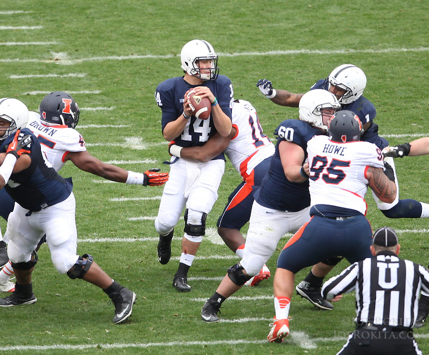 State College, PA - 11/02/2013:  PSU QB Christian Hackenberg (14) is sacked by Eric Finney (14) near the end of the first half.  Penn State defeated Illinois by a score of 24-17 in overtime on Saturday, November 2, 2013, at Beaver Stadium.<br /> <br /> Photos by Joe Rokita / JoeRokita.com