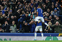 29th October 2019; Goodison Park, Liverpool, Merseyside, England; English Football League Cup, Carabao Cup Football, Everton versus Watford; Mason Holgate of Everton celebrates with team mate Richarlison in front of supporters at the Gwladys Street end after scoring the opening goal after 72 minutes - Strictly Editorial Use Only. No use with unauthorized audio, video, data, fixture lists, club/league logos or 'live' services. Online in-match use limited to 120 images, no video emulation. No use in betting, games or single club/league/player publications