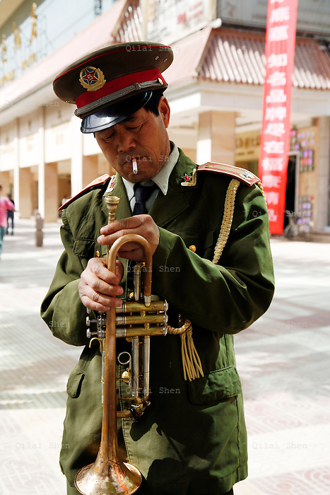 An army band trumpeter gets ready to perform at a promotional event in  Xi'an, Shaanxi Province, China on Tuesday, 01 May 2007.