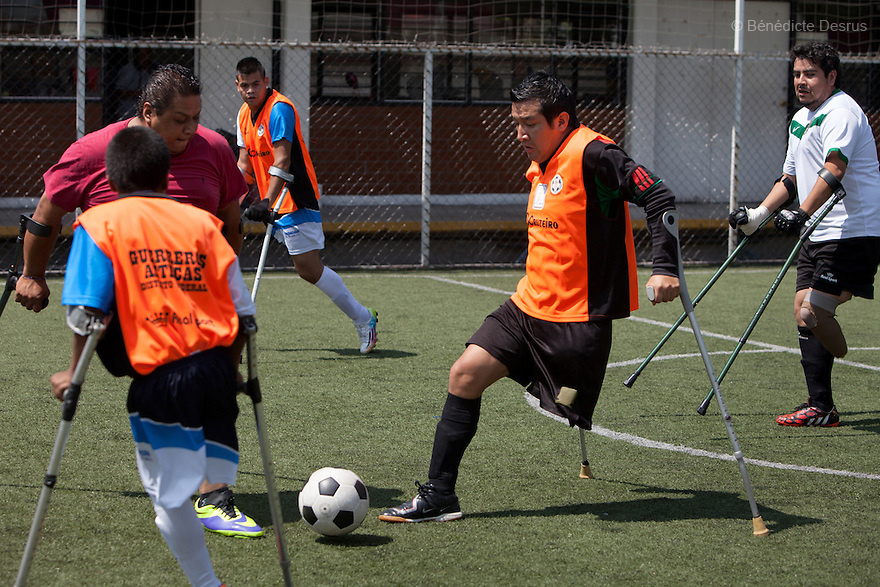 "A player from Guerreros Aztecas controls the ball during a training session with the team in Mexico City, Mexico on August 23, 2014. Guerreros Aztecas (""Aztec Warriors"") is Mexico City's first amputee football team. Founded in July 2013 by five volunteers, they now have 23 players, seven of them have made the national team's shortlist to represent Mexico at this year's Amputee Soccer World Cup in Sinaloa this December. The team trains twice a week for weekend games with other teams. No prostheses are used, so field players missing a lower extremity can only play using crutches. Those missing an upper extremity play as goalkeepers. The teams play six per side with unlimited substitutions. Each half lasts 25 minutes. The causes of the amputations range from accidents to medical interventions – none of which have stopped the Guerreros Aztecas from continuing to play. The players' age, backgrounds and professions cover the full sweep of Mexican society, and they are united by the will to keep their heads held high in a country where discrimination against the disabled remains widespread. (Photo by Bénédicte Desrus)"