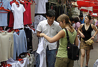People shop & bargain at the Xiu Shui Market in Beijing, China..15-JUN-04