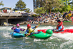 Sage Donnelly, green boat and red helmet, takes the lead in the boater cross competition at the Reno Riverfestival 2014 boatercross